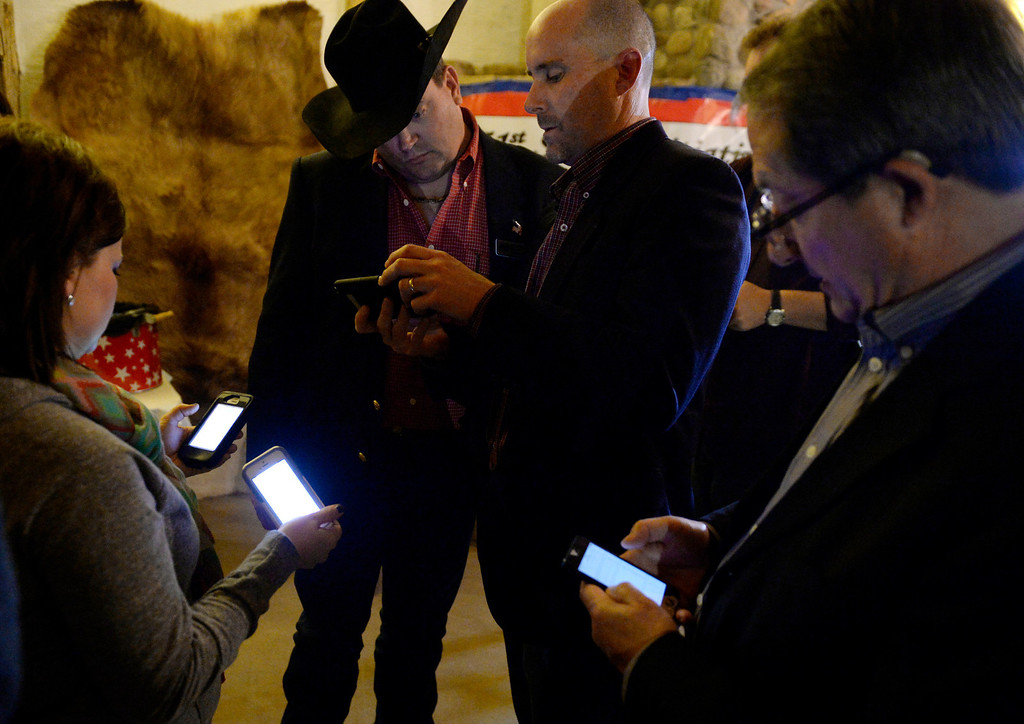. FORT LUPTON, CO - NOVEMBER 05: Supporters of  the 51st State Initiative check results on their phones during an election result watch party at the Historic Fort Lupton Fort, November 05, 2013. Eleven counties are voting to secede from Colorado to form the 51st state. (Photo By RJ Sangosti/The Denver Post)