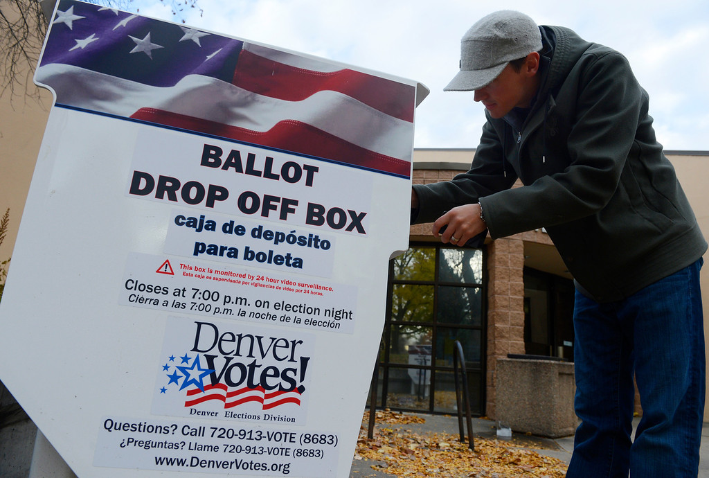 . DENVER, CO - NOVEMBER 05: Denver voter, Chris Blackett, drops of his ballot in a drop off box at the Washington Park Recreation Center Tuesday morning, November 05, 2013. (Photo By Andy Cross/The Denver Post)