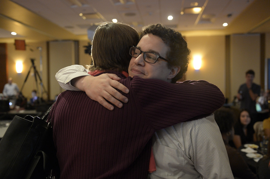 . DENVER, CO. - NOVEMBER 05:  Andrew Freedman, Campaign Director for Amendment 66 hugs a supporter during a watch party for supporters of Amendment 66 at the Marriott City Center in Denver, CO November 05, 2013. Amendment 66 proposes a $950 million tax increase along with a restructuring of Colorado\'s K-12 school finance system. (Photo By Craig F. Walker / The Denver Post)