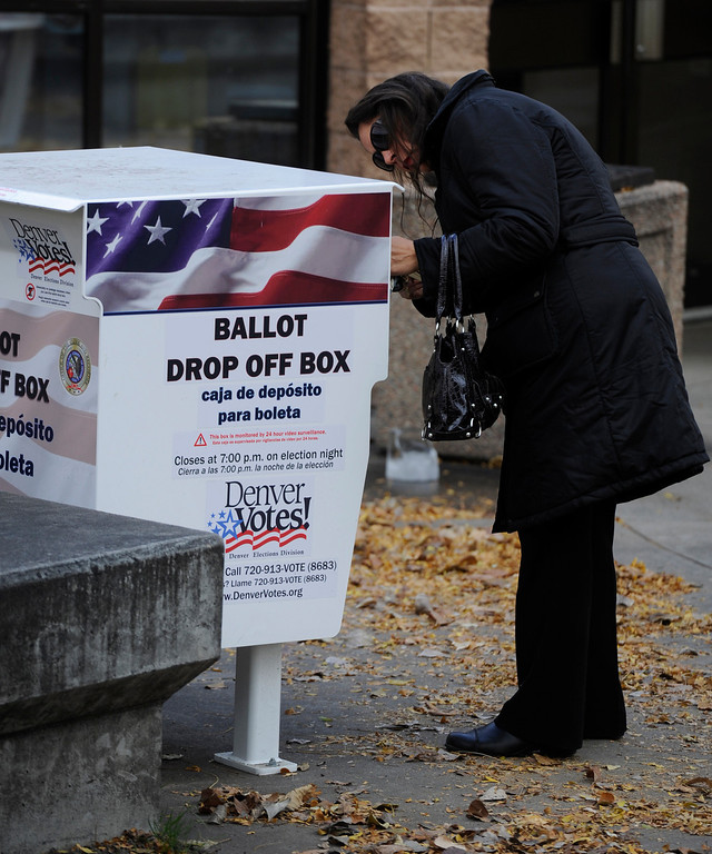 . DENVER, CO - NOVEMBER 05: Mira Morton Luna drops off her ballot at a 24/7 drop off site at the Washington Park Recreation Center Tuesday morning, November 05, 2013. (Photo By Andy Cross/The Denver Post)