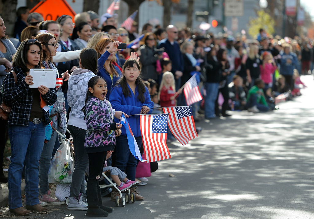 . DENVER, CO - NOV. 9: Crowds gather along Broadway to watch the parade in the largest annual Denver Veteran\'s Day Celebration starting with a 5k run and continuing with the parade and remembrance ceremony downtown next to Civic Center Park, and finishing on the Auraria campus with activities and fireworks. (Photo By Kathryn Scott Osler/The Denver Post)