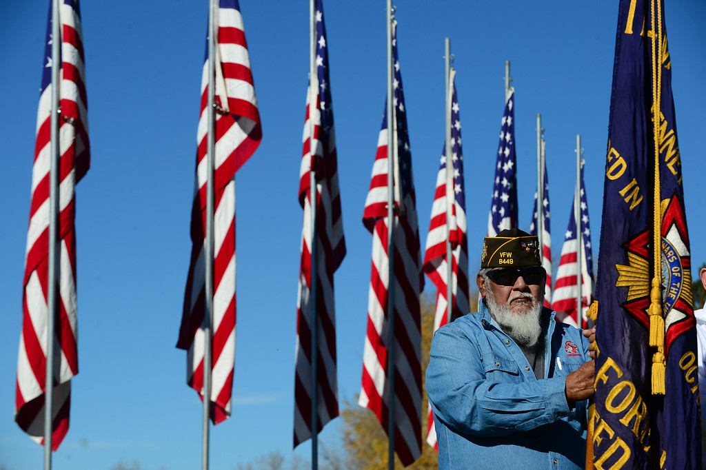 ". Richard Gomez, a member of the All Veteran\'s Honor Guard and with VFW Post  8449, bows his head during the 36th annual Remembrance ceremony of Veteran\'s Day at Fort Logan Cemetery in Lakewood, CO  on November 11, 2013. The day was marked with a 21 gun rifle salute, ""Echo taps\"" played by buglers and the release of white birds of freedom.  The benediction was given by Jackie Newlander.  (Photo By Helen H. Richardson/ The Denver Post)"