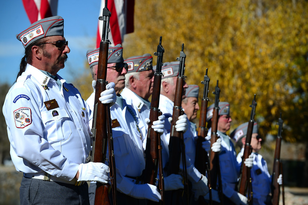 ". LAKEWOOD, CO - NOVEMBER 11, 2013: Members of the All Veterans Honor Guard stand at attention during the 36th annual Remembrance ceremony of Veteran\'s Day at Fort Logan Cemetery in Lakewood, CO  on November 11, 2013. The day was marked with a 21 gun rifle salute, ""Echo taps\"" played by buglers and the release of white birds of freedom.  The benediction was given by Jackie Newlander.  (Photo By Helen H. Richardson/ The Denver Post)"