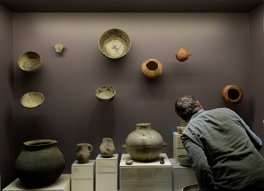 . DENVER, CO. - NOVEMBER 15:  Mount Maker Richard Hards works on a display of ancestral pueblo pottery in the Living West exhibit at the  History Colorado Center in Denver, CO November 15, 2013. The 7,000-square-foot exhibit opens November 23 and and is divided into three sections, Mesa Verde, the Dust Bowl and Our Mountains. (Photo By Craig F. Walker / The Denver Post)