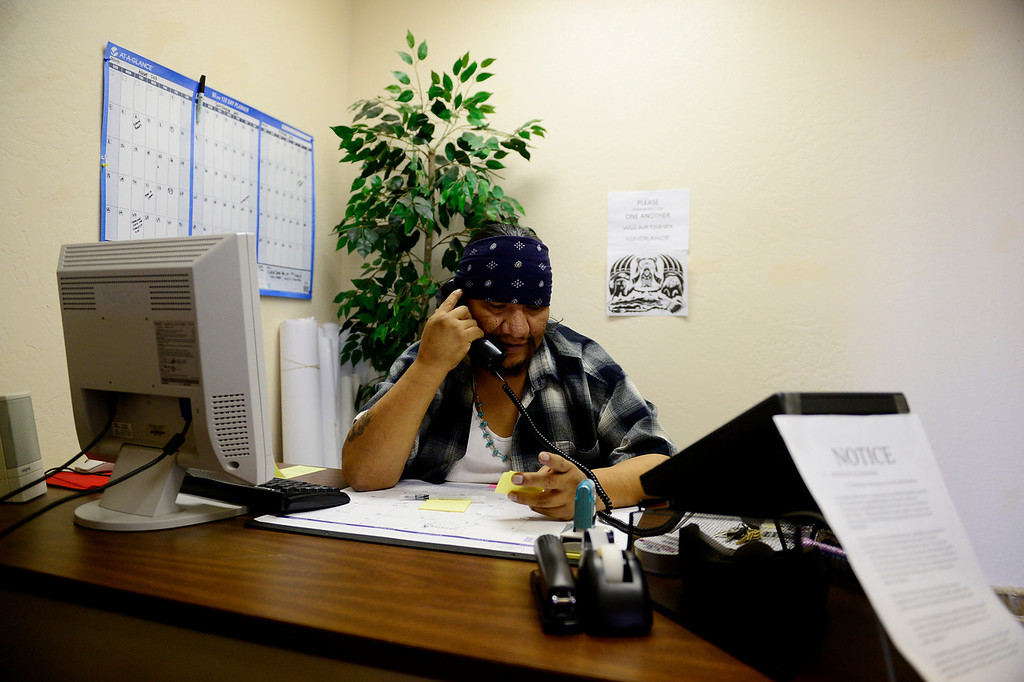 . Election director Charlie Lehi works in his office at the Towaoc municipal building. A recent tribal council election resulted in three of the four open seats to be filled by women -- a first for the tribe. (Photo by AAron Ontiveroz/The Denver Post)