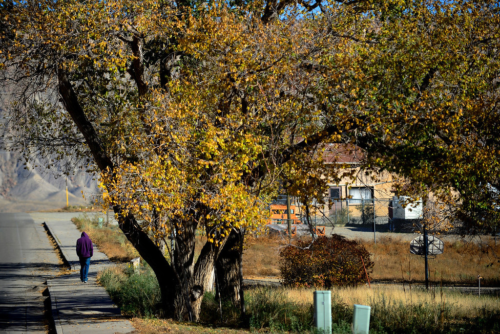 . A young man walks down Mike Wash Road during an afternoon in Towaoc. (Photo by AAron Ontiveroz/The Denver Post)
