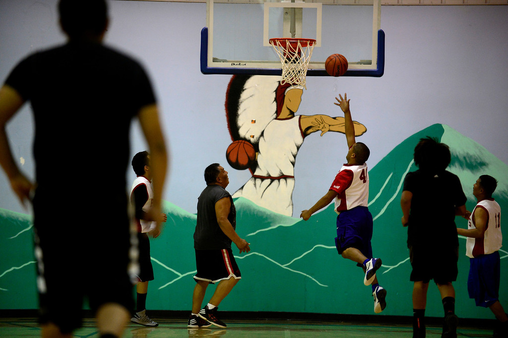 . Men play hoops in a men\'s league basketball matchup at the community recreation center. Basketball is almost a way of life on the reservation as many youths grow up playing the sport. Despite the high level of interest, few leave the reservation to play beyond high school despite a high level of talented players. (Photo by AAron Ontiveroz/The Denver Post)
