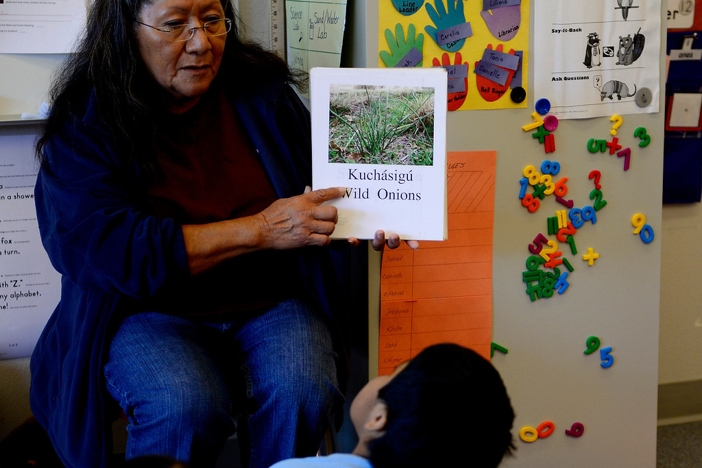 . Helen Muñoz teaches kindergarten students practical words in the Ute language as part of a cultural immersion program. Fearing prejudice against their people, past generations largely stopped teaching their children their native language. For nearly two generations, the Ute language became foreign to the people of the Ute Mountain reservation. In hopes of balancing modernity with tradition, the tribe has begun teaching their youth their native tongue. (Photo by AAron Ontiveroz/The Denver Post)