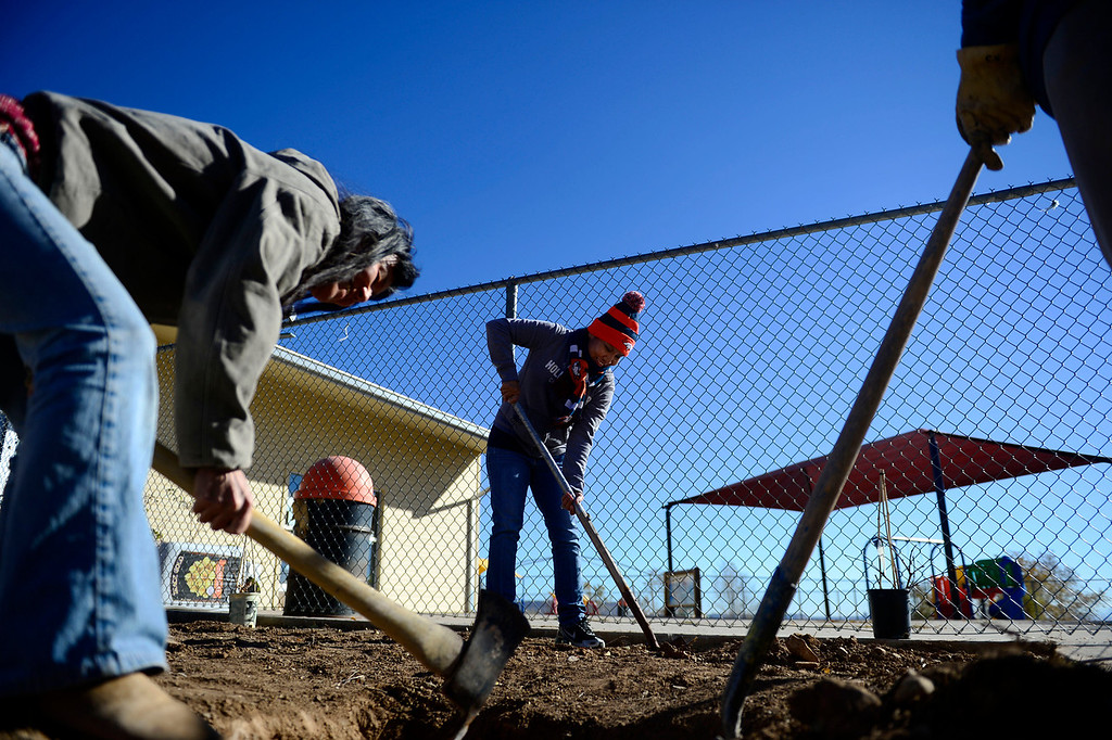 . Sherrell Whiteman helps dig the Ute Mountain Ute reservation\'s Head Start community garden. The garden is being planted in hopes of teaching the youth of the reservation responsibility by planting and eating food they cultivate in their own back yard. Many people on the reservation suffer from diabetes, obesity and alcoholism. (Photo by AAron Ontiveroz/The Denver Post)