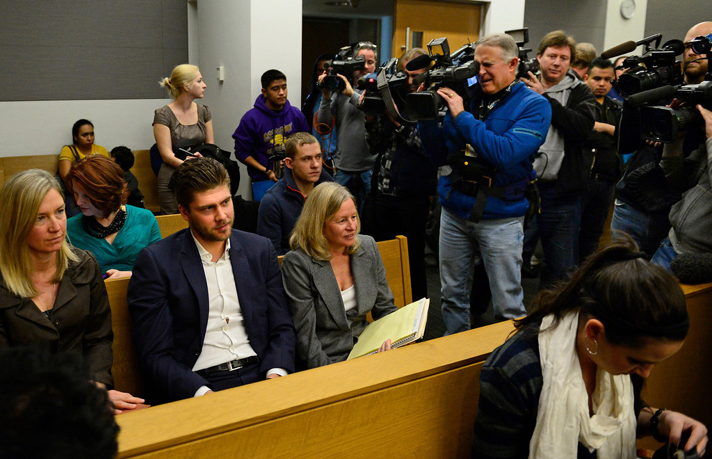 . Semyon Varlamov, starting goaltender for the Colorado Avalanche, sits in court surrounded by media before his hearing started in Denver, December 02, 2013. The judge asked media to leave the court before the hearing started. Varlamov was in court for an advisement hearing related to a misdemeanor assault charge after his girlfriend said he attacked her. (Photo by RJ Sangosti/The Denver Post)