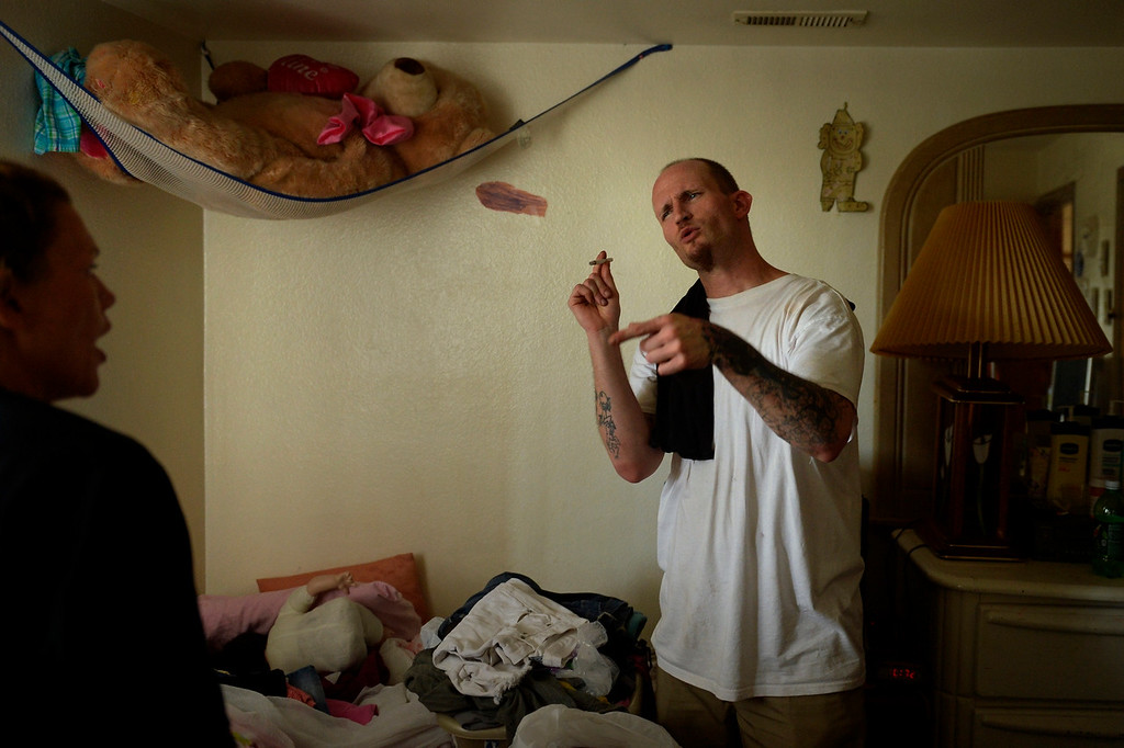 . THORNTON, CO. - July 24: Parolee Thomas Vescio 35, and  Nikki Christos 34 have a slightly heated conversation as they straighten up the apartment where she and her two children live before she leaves for a voluntary 72 hour detox. July 24, 2013 Thornton, Colorado. (Photo By Joe Amon/The Denver Post)