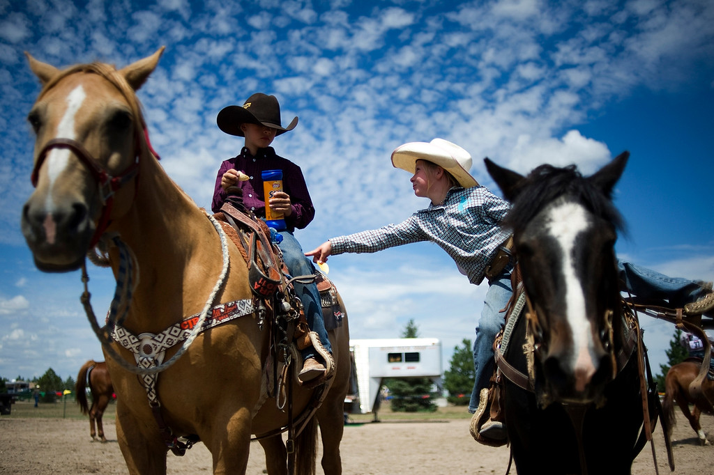 . BURLINGTON, CO - AUGUST 09, 2013: Teagen Binder, 6, pokes Oakley Walters while he eats a stack of chips before the two compete in the flags competition at the rodeo in Burlington, Co.  (Photo By Grant Hindsley/The Denver Post)