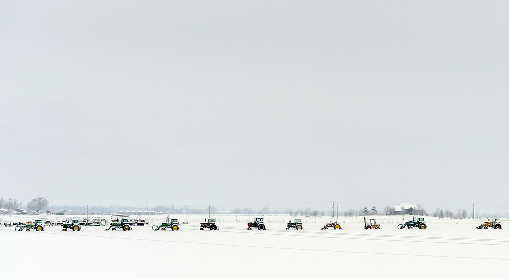 . BERTHOUD, CO-April 16, 2013: Farm equipment is lined up in a field near Berthoud, April 16, 2013. A spring snow storm hit northern Colorado covering the field in fresh snow. (Photo By RJ Sangosti/The Denver Post)