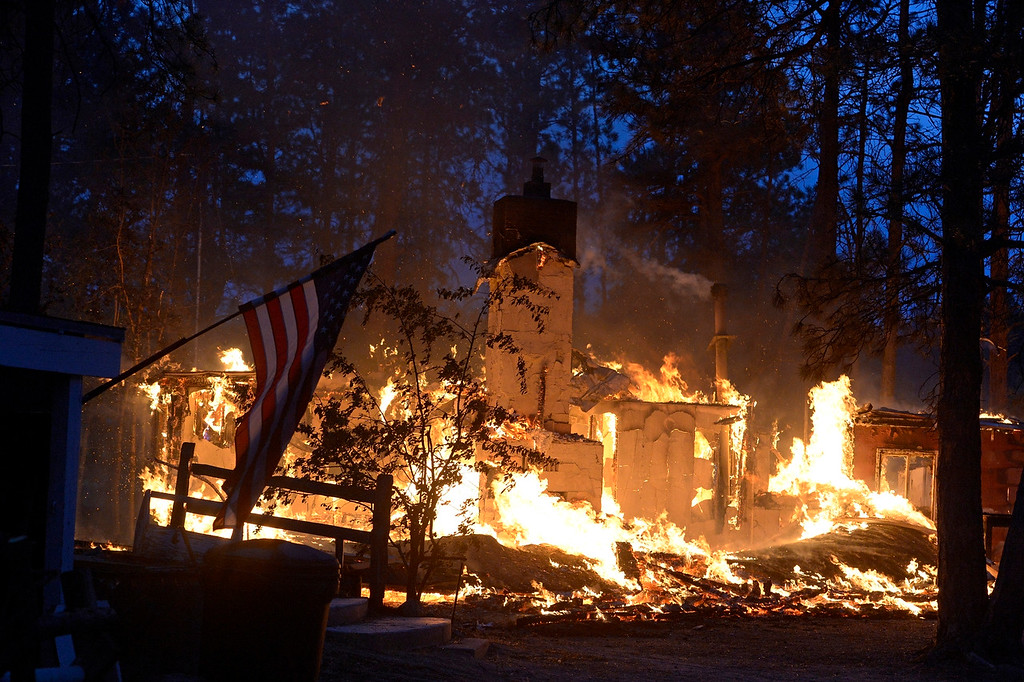 . COLORADO SPRINGS, CO - JUNE 12: A house is fully engulfed with flames in the midst of the Black Forest Fire northeast of Colorado Springs on June 12, 2013.  .   Photo by Helen H. Richardson/The Denver Post)