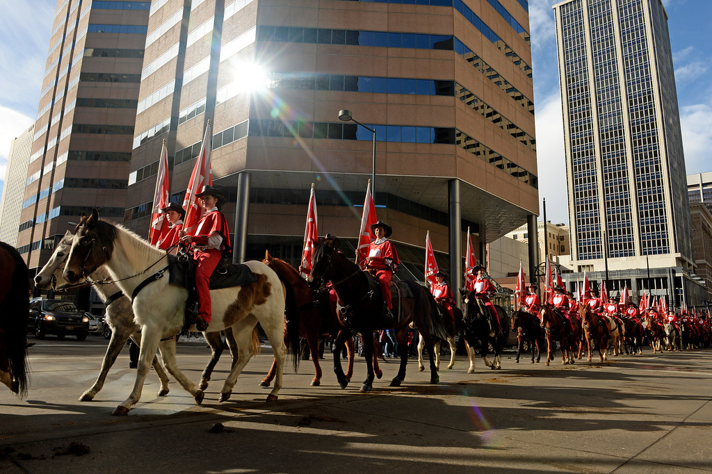 . DENVER, CO - JANUARY 9, 2014:  Members of the Westernaires march in the National Western Stock Show Parade along 17th street  in Denver, Co on January 9, 2014.  The National Western Stock Show Kick-Off Parade featured Longhorn cattle herded through the streets of downtown Denver, along with bands, horses, floats, cowboys and rodeo queens. The parade started at noon at Union Station in Lower downtown Denver and headed up 17th street.   The annual National Western Stock Show runs Jan. 11-26. Schedules and ticket information is available at NationalWestern.com.  (Photo By Helen H. Richardson/ The Denver Post)