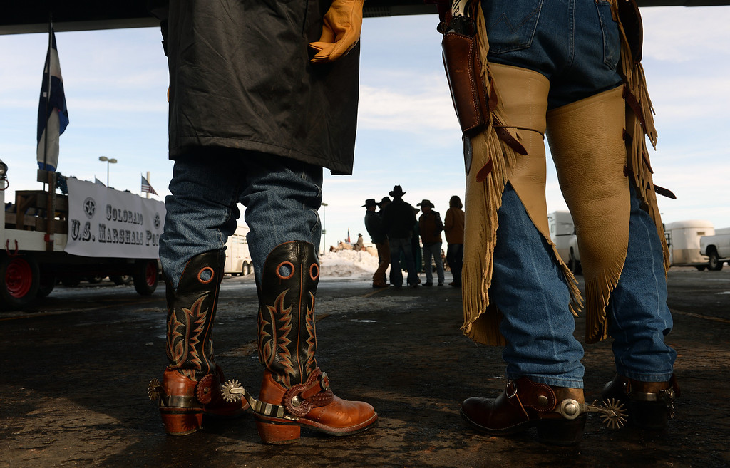 . DENVER, CO - JANUARY 9, 2014:  Jack Kersbergen, of Thornton, left, and Danny Zyla, of Golden, members of the Colorado US Marshall Posse, are dressed to the nines for the National Western Stock Show Parade in Denver, Co on January 9, 2014.  The National Western Stock Show Kick-Off Parade featured Longhorn cattle herded through the streets of downtown Denver, along with bands, horses, floats, cowboys and rodeo queens. The parade started at noon at Union Station in Lower downtown Denver and headed up 17th street.   The annual National Western Stock Show runs Jan. 11-26. Schedules and ticket information is available at NationalWestern.com.  (Photo By Helen H. Richardson/ The Denver Post)
