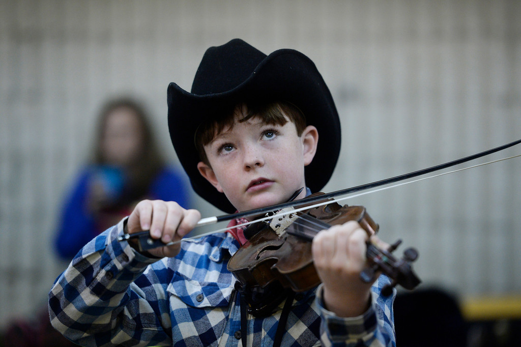 . DENVER, CO. - JANUARY 11:  Julian Oliver, 9, from Pagosa Springs Colorado, warms-up before playing in the Colorado Fiddle Championships on opening day of the National Western Stock Show Saturday, January 10, 2014. (Photo By Andy Cross / The Denver Post)