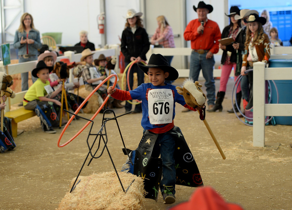 . DENVER, CO. JANUARY 25: Matteus Roybal, 5, of Denver ropes a stick steer at Ames Activity Pavilion at the National Western Stock Show in Denver, Colorado January 25, 2014. Twenty-eight children competed in the event. (Photo by Hyoung Chang/The Denver Post)