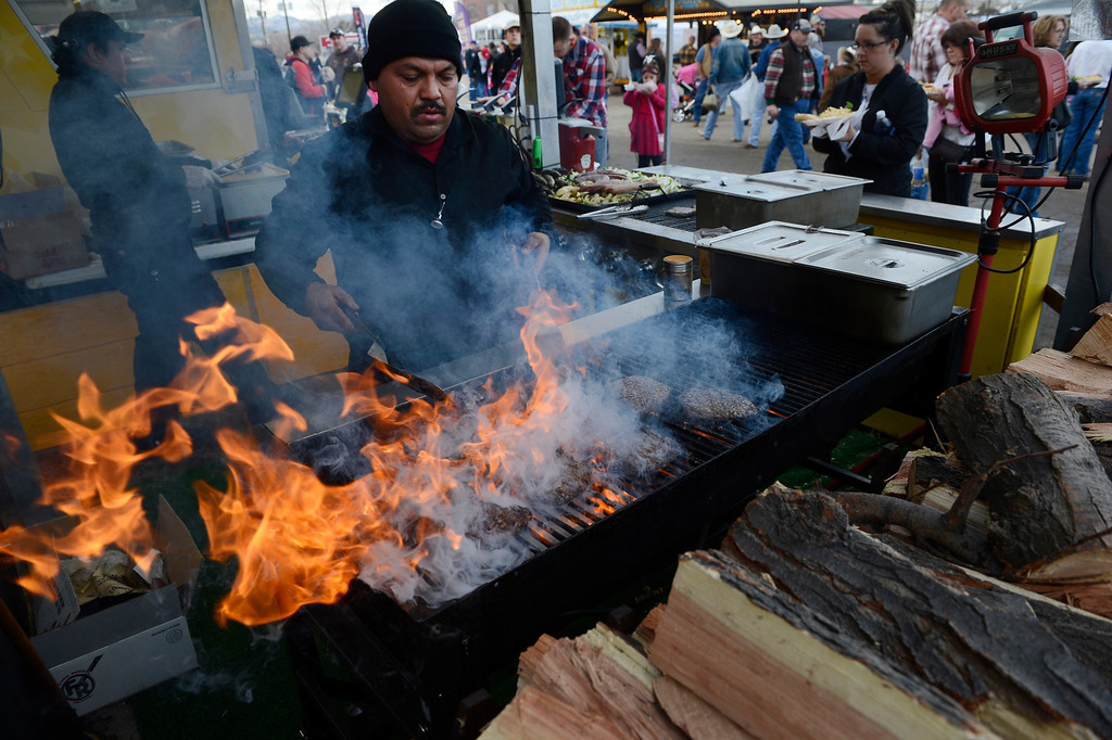 . DENVER, CO. - JANUARY 11:  Armando Contreras, tends to hamburgers on the grill on opening day of the National Western Stock Show Saturday, January 10, 2014. (Photo By Andy Cross / The Denver Post)