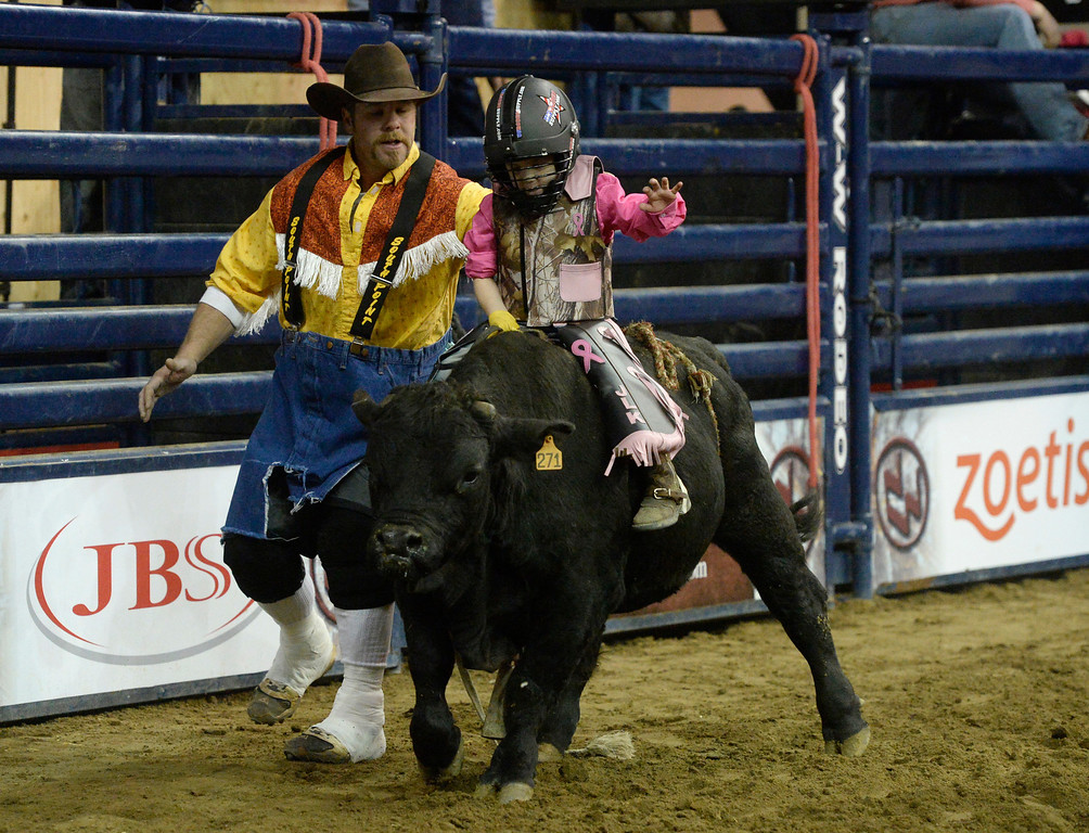 . DENVER, CO. - JANUARY 11:  Jordan Kane, 5, rides a miniature bull during the Colorado Vs The World Rodeo on opening day of the National Western Stock Show Saturday, January 10, 2014. (Photo By Andy Cross / The Denver Post)