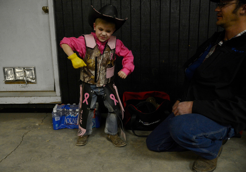 . DENVER, CO. - JANUARY 11:  Jordan Kane, 5, gets animated with his dad, Brian Kane, after his ride on a miniature bull during the Colorado Vs The World Rodeo on opening day of the National Western Stock Show Saturday, January 10, 2014. (Photo By Andy Cross / The Denver Post)