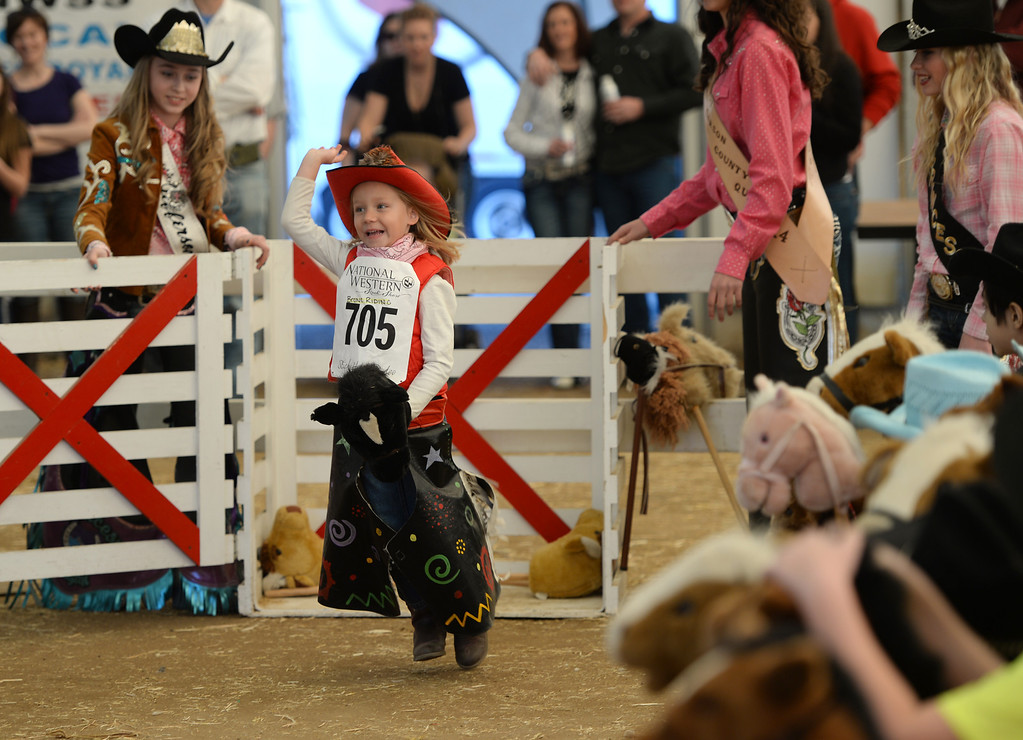 . DENVER, CO. JANUARY 25: Kira Butchart, 6, rides her stick horse at Ames Activity Pavilion at the National Western Stock Show in Denver, Colorado January 25, 2014. Twenty-eight children competed in the event. (Photo by Hyoung Chang/The Denver Post)