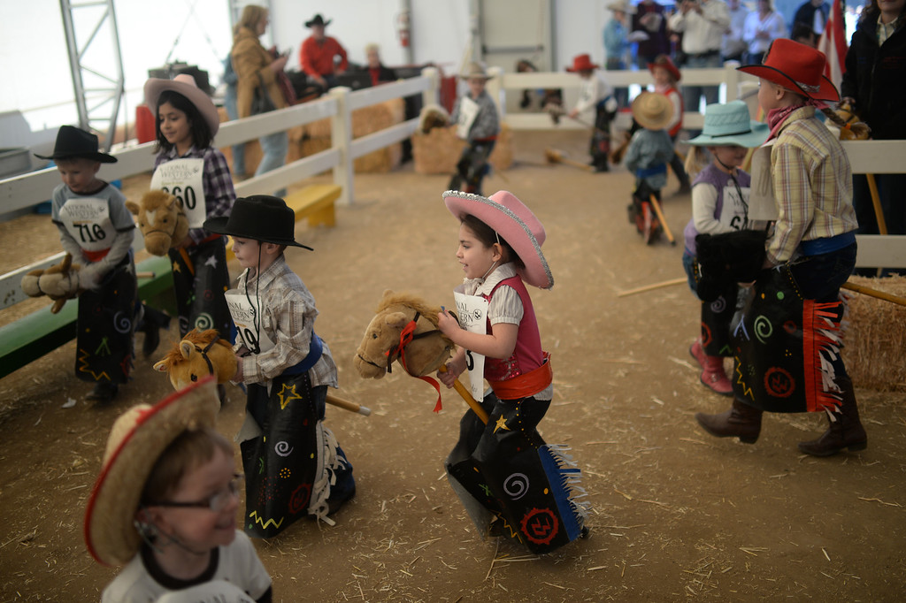 . DENVER, CO. JANUARY 25:  Children warm up for the stick horse rodeo at Ames Activity Pavilion at the National Western Stock Show in Denver, Colorado January 25, 2014. Twenty-eight children competed in the event. (Photo by Hyoung Chang/The Denver Post)