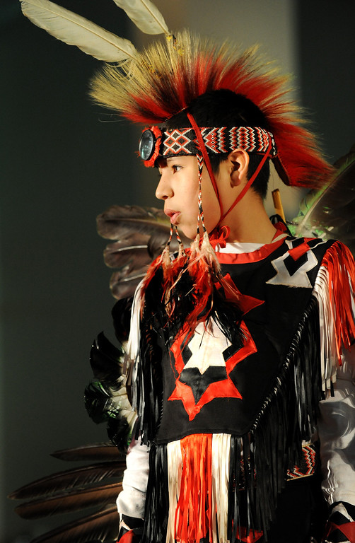 . Donahven Beaver, 11, prepares to dance with his family - all members of the Comanche and Kiowa tribes - during the Colorado Indian Market on Jan. 19 at the Denver Mart in Denver, Colo. Photo by Jamie Cotten, Special to The Denver Post