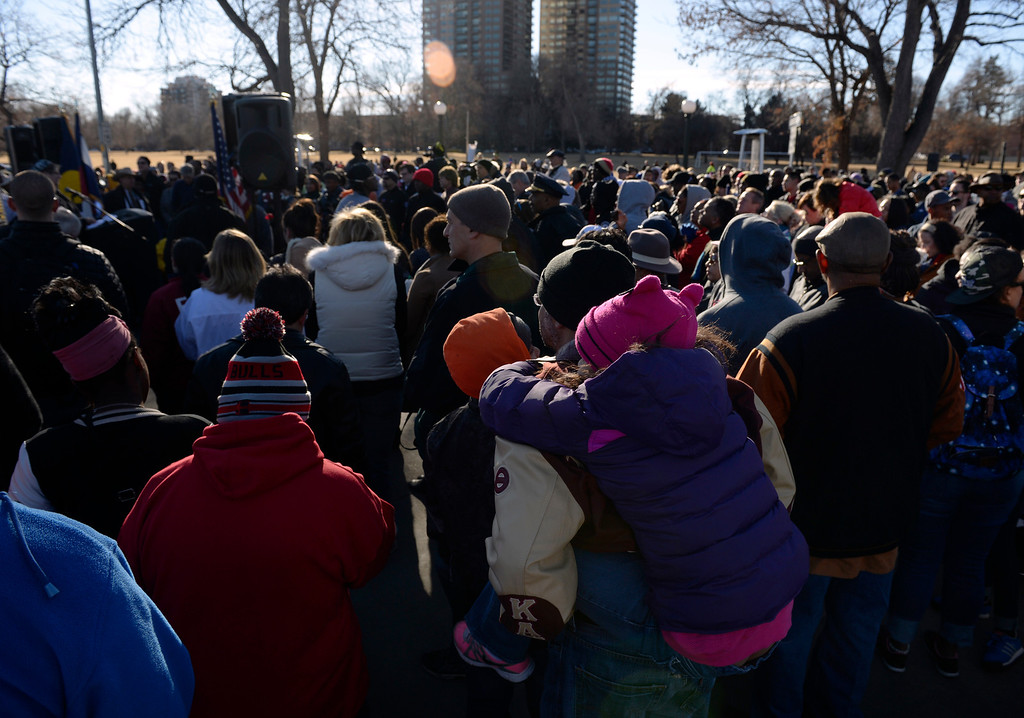 . The 29th annual Martin Luther King, Jr. Marade takes place with participants gathering at the King memorial site in City Park in Denver to listen to speeches and songs honoring King. Then the crowd makes its way marching down E. Colfax Ave. to Civic Center Park where birthday cake is served to all. (Photo by Kathryn Scott Osler/The Denver Post)