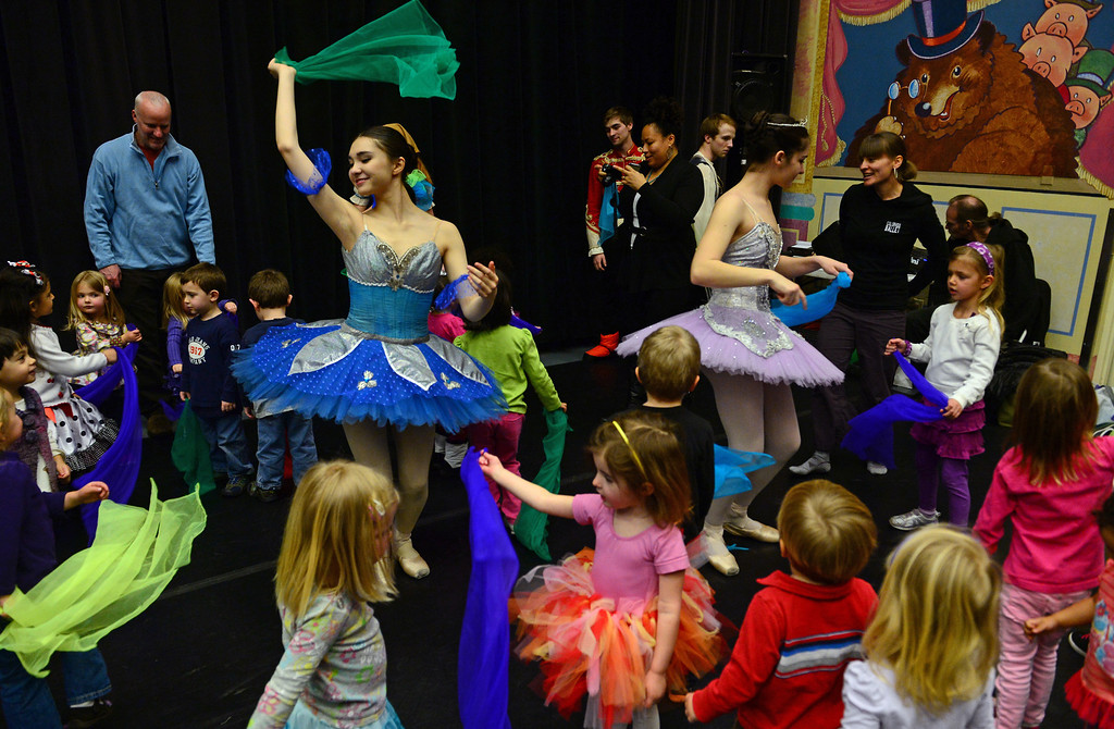 ". DENVER, CO - FEBRUARY 9,  2014:  Ballet dancers Ryan Lee, in blue, left, and Emma Daddario, in purple, right, use scarves with the young children to teach them how to move to music after their performances at the Children\'s Museum in Denver,  CO on February 9, 2014. Colorado Ballet hosts ""From the Page to the Stage\"" performances at schools, hospitals, museums and libraries.  During these performances, Colorado Ballet Studio Company dancers perform excerpts from ballets based on Shakespeare and the classics such as the upcoming production of Cinderella.  The outreach program makes more than 60,000 contacts each year.   (Photo By Helen H. Richardson/ The Denver Post)"