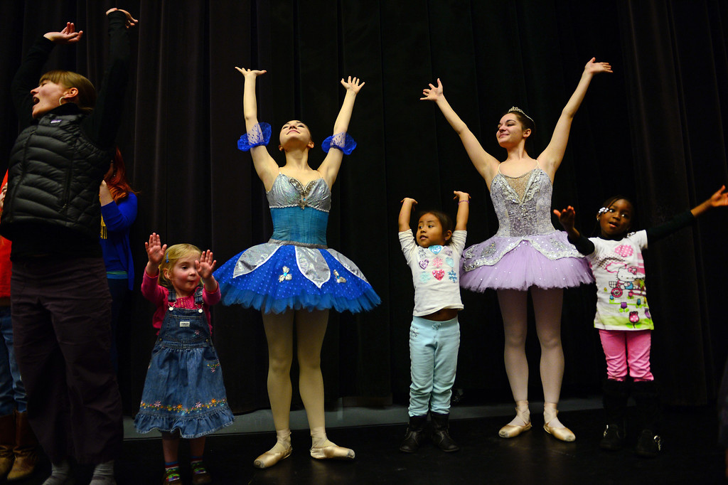 ". DENVER, CO - FEBRUARY 9,  2014:  Ballet dancers Ryan Lee, in blue, and Emma Daddario, in purple, lead from left to right:  Eve Goeke, 3, Marlene Reyes, 5 and Wonenouon Some, 5, in some warm up dance moves after their performances at the Children\'s Museum in Denver,  CO on February 9, 2014. Colorado Ballet hosts ""From the Page to the Stage\"" performances at schools, hospitals, museums and libraries.  During these performances, Colorado Ballet Studio Company dancers perform excerpts from ballets based on Shakespeare and the classics such as the upcoming production of Cinderella.  The outreach program makes more than 60,000 contacts each year.   (Photo By Helen H. Richardson/ The Denver Post)"