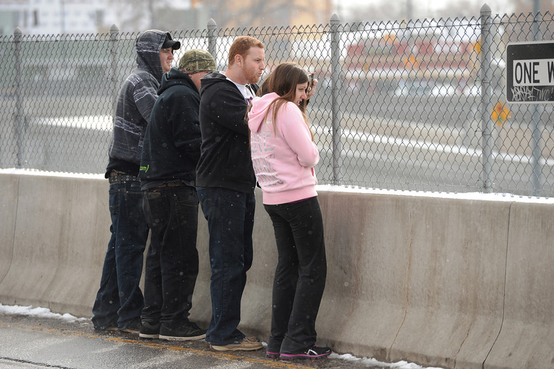 . DENVER MARCH 1: People are watching car accident site near North bound of I-25 Logan Exit.  Denver, Colorado. March 1. 2014. (Photo by Hyoung Chang/The Denver Post)