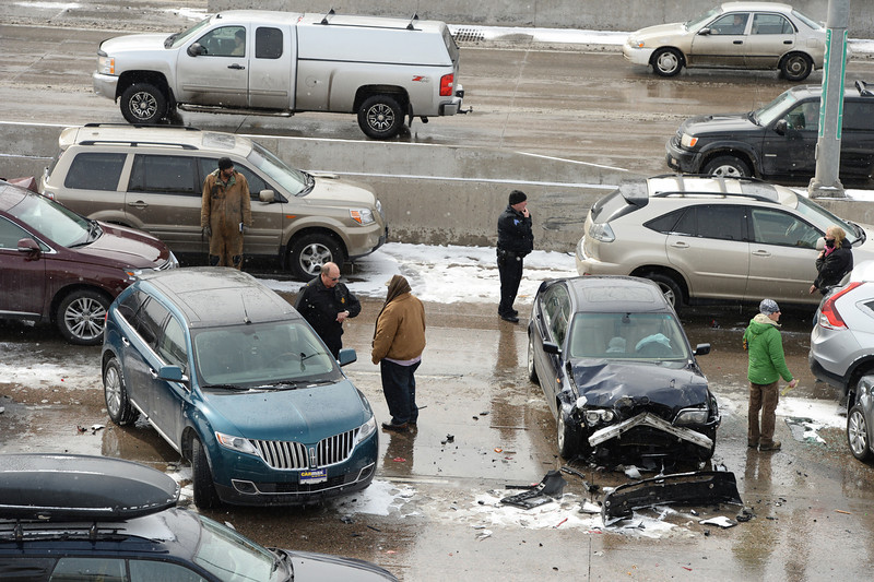 . DENVER MARCH 1: Officials are investigating car accident site near North bound of I-25 Logan Exit.  Denver, Colorado. March 1. 2014. (Photo by Hyoung Chang/The Denver Post)