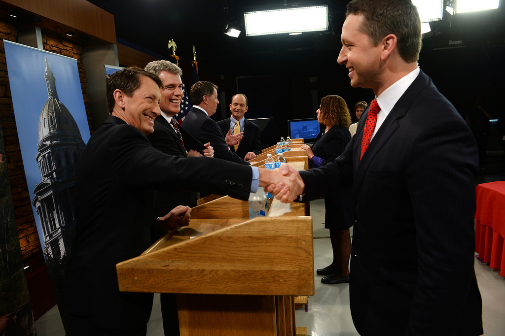. KDVR Fox 31 political reporter and moderator Eli Stokols shakes hands with Gubernatorial candidate and state senator Greg Brophy, left, after the gubernatorial debate at KDVR Fox 31 in Denver, Co on March 2,  2014.  The other candidates  are from left to right:  Colorado Secretary of State Scott Gessler, Adams County businessman Steve House and former state senator Mike Kopp. The Colorado gubernatorial candidates squared off for a debate at the KDVR Fox31 television station studios that was co-moderated by KDVR political reporter Eli Stokols and Colorado Springs Gazette Telegraph reporter Pula Davis in Denver,  Co on March 2, 2014. The four out of the seven candidates that participated were Colorado Secretary of State Scott Gessler, private businessman Steve House, Senator Greg Brophy, and former state senator Mike Kopp.  (Photo By Helen H. Richardson/ The Denver Post)