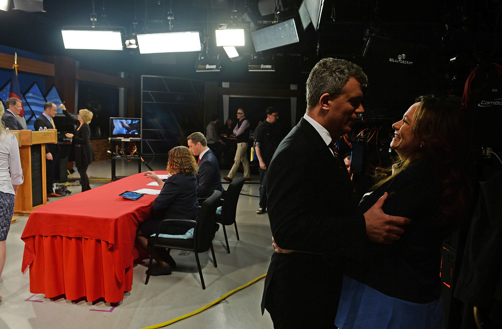 . Gubernatorial candidate and Colorado secretary of state Scott Gessler embraces his wife Kristi, right, during a break in the gubernatorial debate at KDVR Fox 31 in Denver, Co on March 2,  2014.   The Colorado gubernatorial candidates squared off for a debate at the KDVR Fox31 television station studios that was co-moderated by KDVR political reporter Eli Stokols and Colorado Springs Gazette Telegraph reporter Pula Davis in Denver,  Co on March 2, 2014. The four out of the seven candidates that participated were Colorado Secretary of State Scott Gessler, private businessman Steve House, Senator Greg Brophy, and former state senator Mike Kopp.  (Photo By Helen H. Richardson/ The Denver Post)