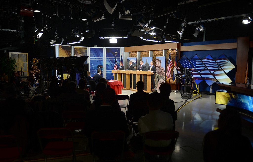 . Gubernatorial candidates line up in front of co-moderators Eli Stokols, right front, and Pula Davis, left,  during  the  gubernatorial debate at KDVR Fox 31 in Denver, Co on March 2,  2014.  They are from left to right:  State senator Greg Brophy, Secretary of State Scott Gessler, Adams County Businessman Steve House, and former state senator Mike Kopp. The Colorado gubernatorial candidates squared off for a debate at the KDVR Fox31 television station studios that was co-moderated by KDVR political reporter Eli Stokols and Colorado Springs Gazette Telegraph reporter Pula Davis in Denver,  Co on March 2, 2014. The four out of the seven candidates that participated were Colorado Secretary of State Scott Gessler, private businessman Steve House, Senator Greg Brophy, and former state senator Mike Kopp.  (Photo By Helen H. Richardson/ The Denver Post)