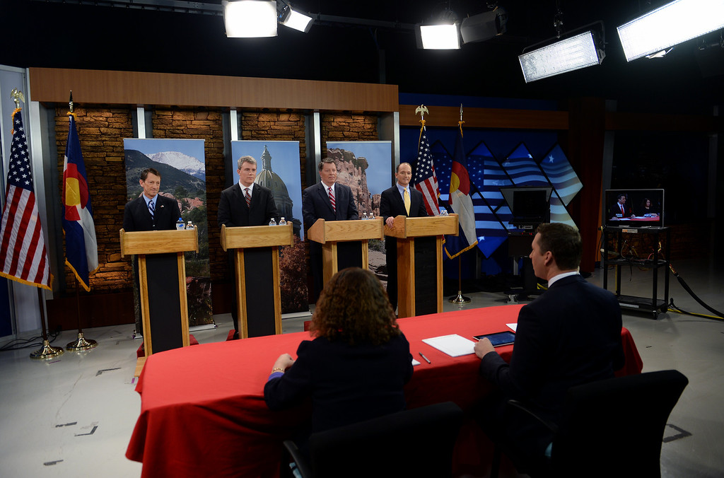 . Gubernatorial candidates answer questions from  co-moderators Eli Stokols, right front, and Pula Davis, left, during the  gubernatorial debate at KDVR Fox 31 in Denver, Co on March 2,  2014.  They are from left to right:  State senator Greg Brophy, Secretary of State Scott Gessler, Adams County Businessman Steve House, and former state senator Mike Kopp. The Colorado gubernatorial candidates squared off for a debate at the KDVR Fox31 television station studios that was co-moderated by KDVR political reporter Eli Stokols and Colorado Springs Gazette Telegraph reporter Pula Davis in Denver,  Co on March 2, 2014. The four out of the seven candidates that participated were Colorado Secretary of State Scott Gessler, private businessman Steve House, Senator Greg Brophy, and former state senator Mike Kopp.  (Photo By Helen H. Richardson/ The Denver Post)