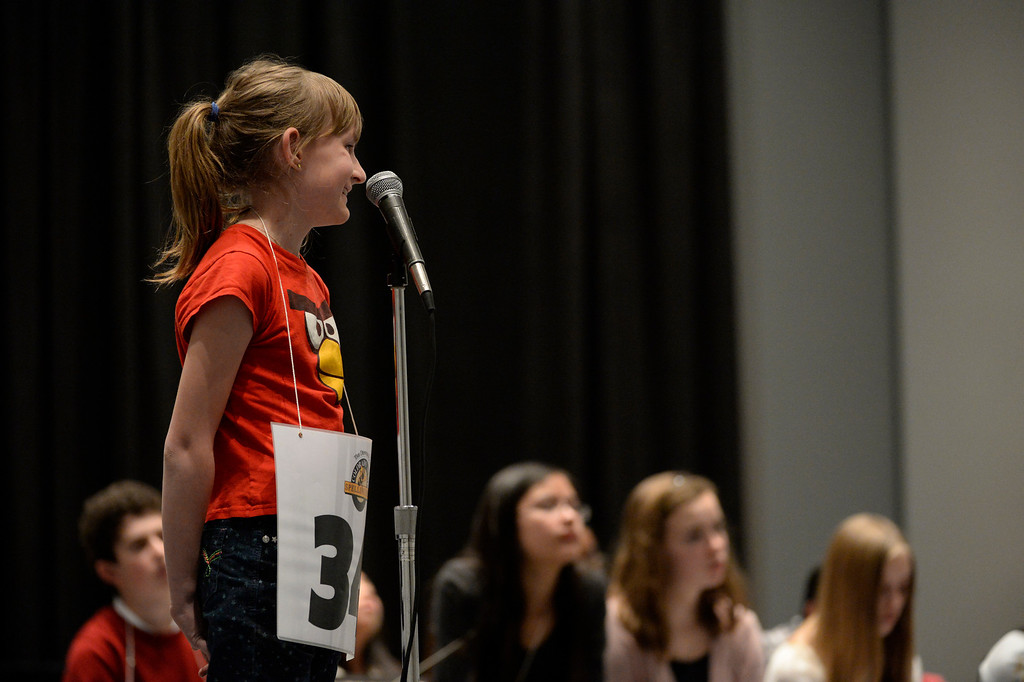 . DENVER, CO. - MARCH 08: Sylvie Lamontagne, 6th grader at Kendrick Lakes Elementary, smiles as a definition of a word is given to her during the 74TH Annual Colorado State Spelling Bee Saturday, March 08, 2014 at the Colorado Convention Center. (Photo By Andy Cross / The Denver Post)