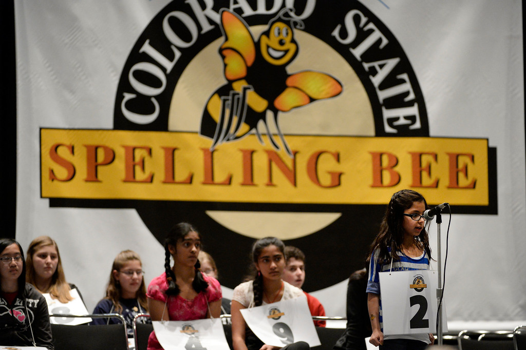 . DENVER, CO. - MARCH 08: Cheyenne Trujillo, a third grader at Hackberry Elementary School, spells out a word a the 74TH Annual Colorado State Spelling Bee Saturday, March 08, 2014 at the Colorado Convention Center. (Photo By Andy Cross / The Denver Post)