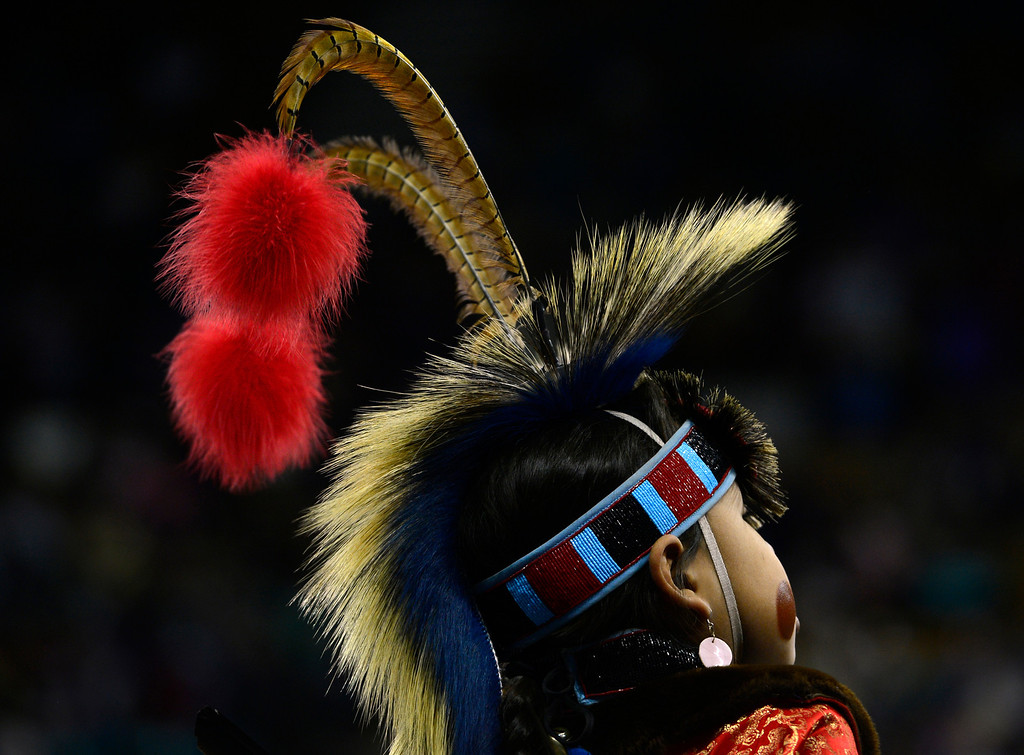 . DENVER, CO - MARCH 22: A participant pauses for a short rest during the Junior Boys Grass competition. in theThe Denver March Pow Wow takes place at the Denver Coliseum as a number of American Indian tribes participate in dance competitions and host arts and crafts sales, fry-bread concessions, as well as storytelling and demonstrations. The event continues through Sunday with a grand entry parade at 11 a.m. (Kathryn Scott Osler The Denver Post)