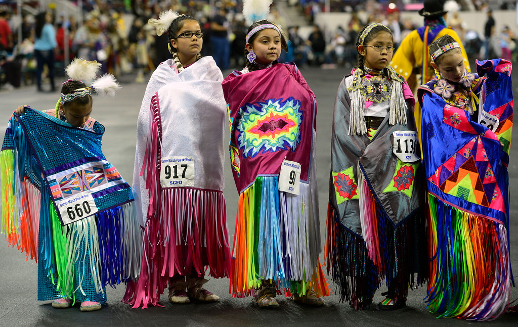 . DENVER, CO - MARCH 22: After dancing, participants pause in front of the judges table in the Junior Girls Fancy competition. The Denver March Pow Wow takes place at the Denver Coliseum as a number of American Indian tribes participate in dance competitions and host arts and crafts sales, fry-bread concessions, as well as storytelling and demonstrations. The event continues through Sunday with a grand entry parade at 11 a.m. (Kathryn Scott Osler The Denver Post)
