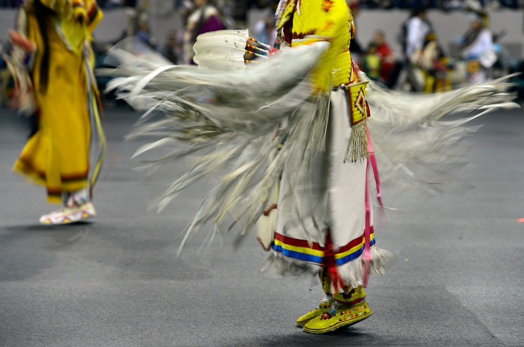 . DENVER, CO - MARCH 22: Participants perform in the Junior Girls Traditional competition. The Denver March Pow Wow takes place at the Denver Coliseum as a number of American Indian tribes participate in dance competitions and host arts and crafts sales, fry-bread concessions, as well as storytelling and demonstrations. The event continues through Sunday with a grand entry parade at 11 a.m. (Kathryn Scott Osler The Denver Post)