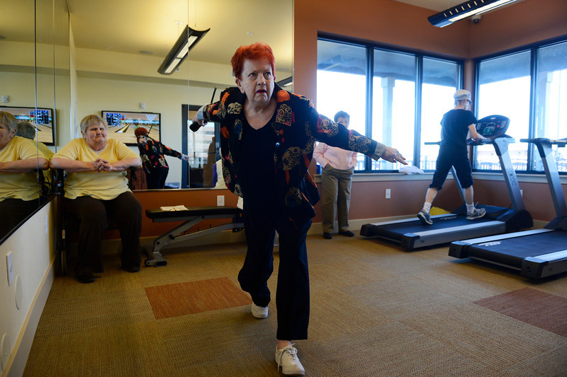. WHEAT RIDGE, CO.- MARCH 20: Dorthy Schelske, center, takes her turn during a game of Wii bowling in the fitness room at the Wheat Ridge Town Center Apartments , a new senior housing community, Thursday morning, March 20, 2014. The center offers a variety of on-site activities including coffee bar, Tai Chi, Wii bowling, fitness room, and gardening. (Photo By Andy Cross / The Denver Post)