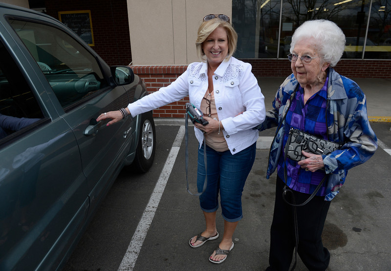 . LITTLETON, CO. - MARCH 26:  Columbine Community Village volunteer, Lonnie Leasman, left, escorts Arlene Molis, 95, to Leasman\'s car to give Molis a ride back home after Molis got her hair done at the New Creations hair salon Wednesday afternoon, March 26, 2014. (Photo By Andy Cross / The Denver Post)