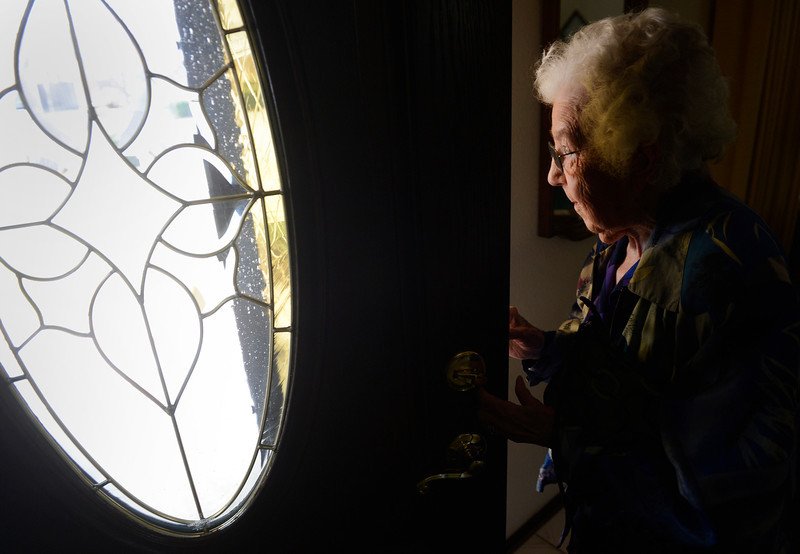 . LITTLETON, CO. - MARCH 26:  Arlene Molis, 95, peeks out of her front door, checking to see if her ride had arrived, a volunteer from the Columbine Community Village, before heading out to her weekly hair appointment, Wednesday afternoon, March 26, 2014. (Photo By Andy Cross / The Denver Post)