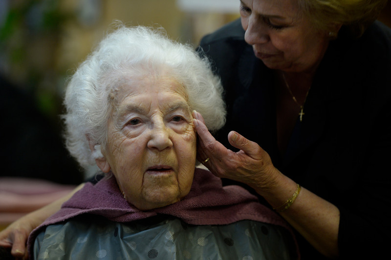 . LITTLETON, CO. - MARCH 26:  Hairstylist, Nancy Evans, right, uses a gentle touch working with client, Arlene Molis at the New Creations hair salon Wednesday afternoon, March 26, 2014. Molis, 95-years-old, gets her hair done weekly at the salon, getting a ride from volunteers at the Columbine Community Village. (Photo By Andy Cross / The Denver Post)