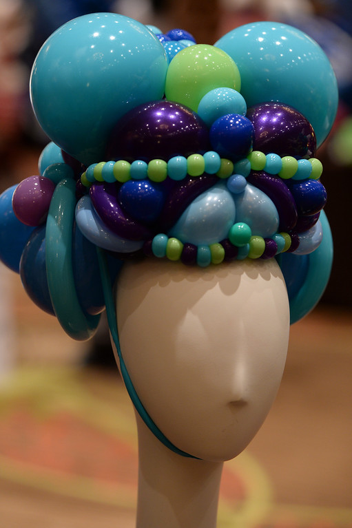 . A whimsical hat made up entirely of balloons was one of dozens of creative designs at The international World Balloon Convention which had it\'s last day with the showing of the festival of balloons inside the ballroom at The Sheraton in downtown Denver.  Photo By Helen H. Richardson/ The Denver Post)