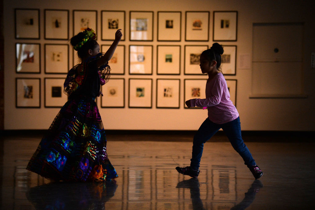 . Aaliyah Andrade (left) chases Adrianna Villalpando after the performance. The Día del Niño celebration of culture on Sunday, April 27, 2014. (Photo By AAron Ontiveroz/ The Denver Post)