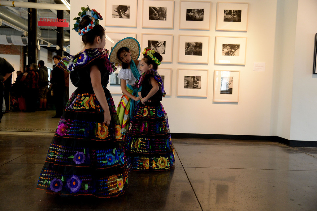 . Natasha Andrade helps adjust the dress of Aaliyah Andrade as Danna Meiga looks on. The Día del Niño celebration of culture on Sunday, April 27, 2014. (Photo By AAron Ontiveroz/ The Denver Post)