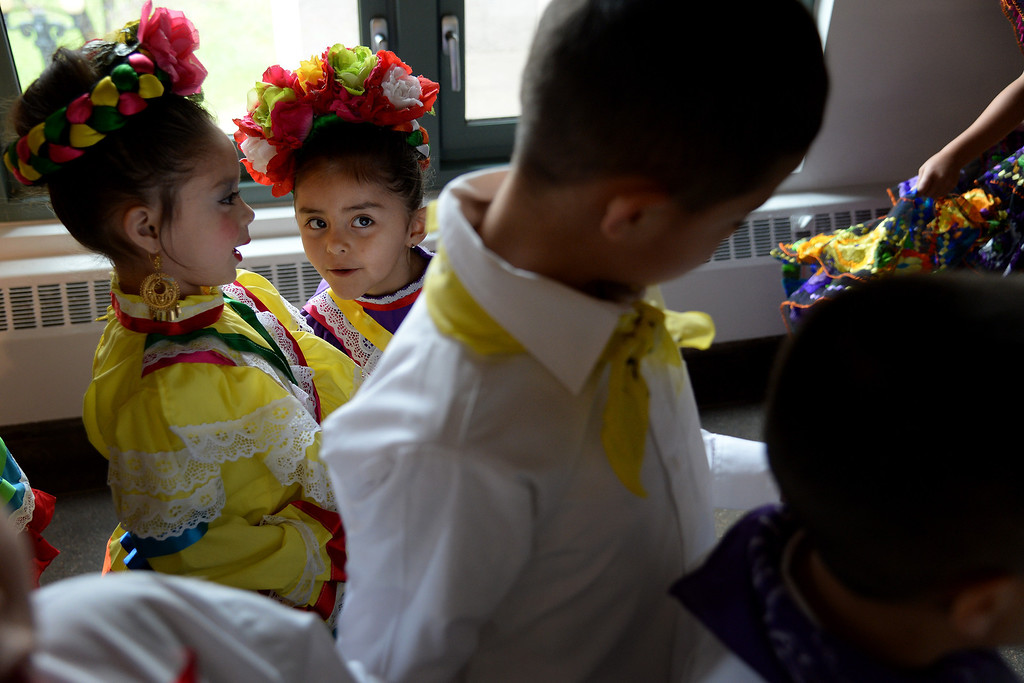 . Ariana Ramierez (right), 4, shares a secret with Amerie Herrera, 4, as they wait to take the dance floor. The Día del Niño celebration of culture on Sunday, April 27, 2014. (Photo By AAron Ontiveroz/ The Denver Post)
